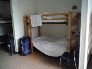 HI-Chicago dorms featured the best of both worlds: partial walls around the beds for more privacy, but tall bunks, high ceilings, and an extra foot of room between the bed and wall to accommodate tall people.