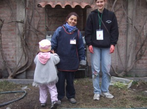 Comparing heights with little Angela and her tutora. This is one of the local women who are hired to care for the orphans, thus forming a long-lasting and mutually effective relationship.