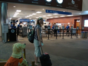 Me with my now-retired carry-on. I'm slightly hunched-down in this picture, and it's not because my backpack's heavy.